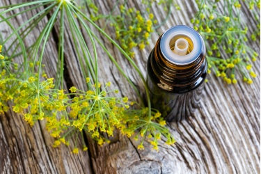 bigstock-a-bottle-of-dill-seed-oil-with-244673473